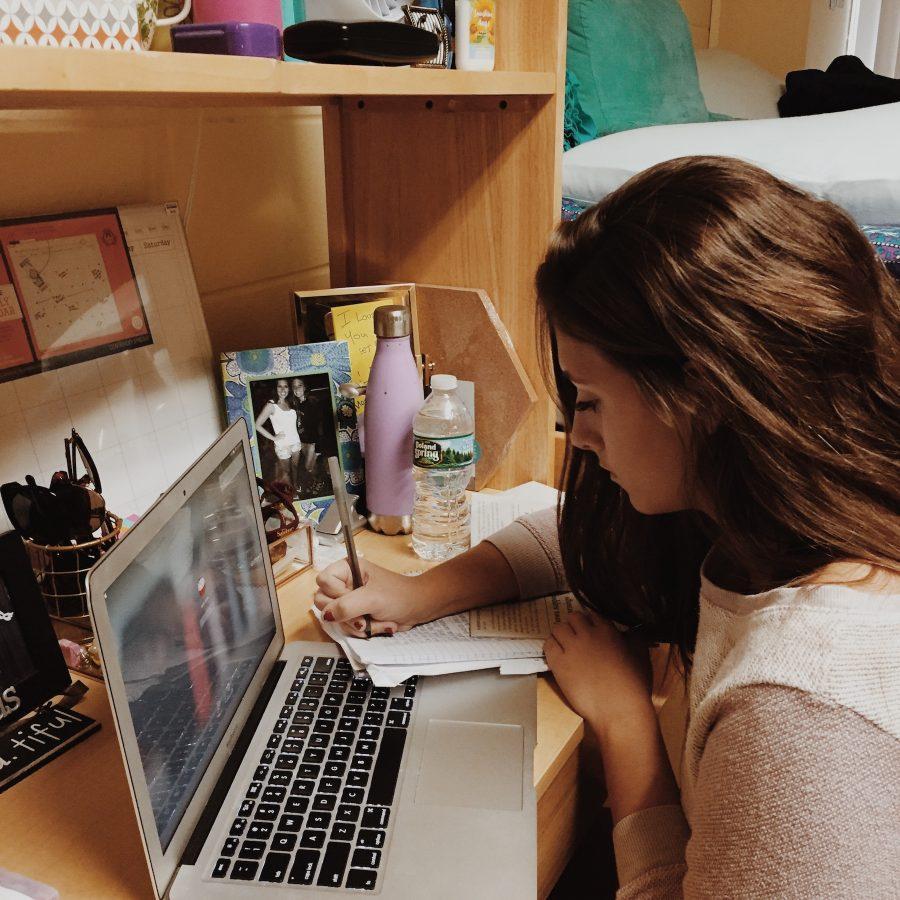 Caitlin+Burke%2C+class+of+2016%2C+works+at+her+desk+inside+her+dorm+room+at+Salisbury+University+in+Maryland.