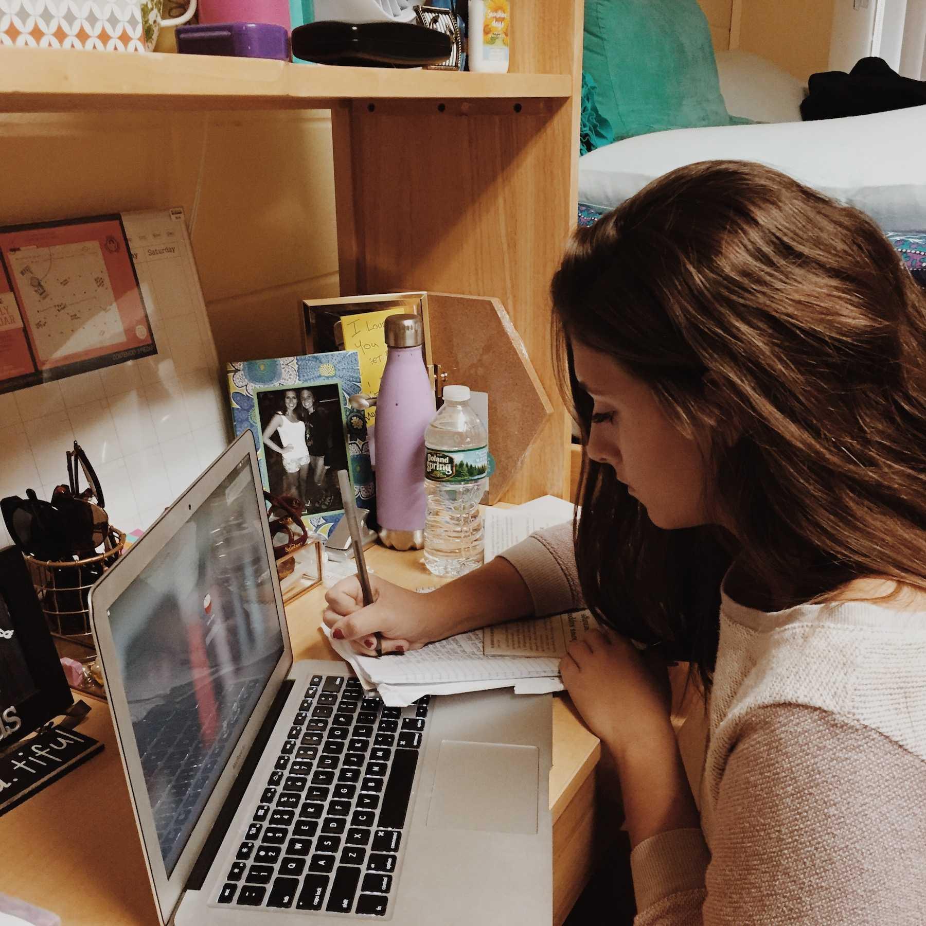 Caitlin Burke, class of 2016, works at her desk inside her dorm room at Salisbury University in Maryland.