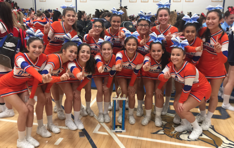 Varsity, JV cheerleaders win FCIAC titles
