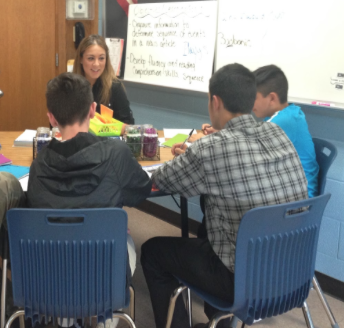 English teacher Andrea DeLotto works with a group of students in the school's new Read 180 program, which is designed to help ninth-graders enhance their reading skills and bring those skills to grade level. English teacher Casey Duffy is also an instructor in the program.