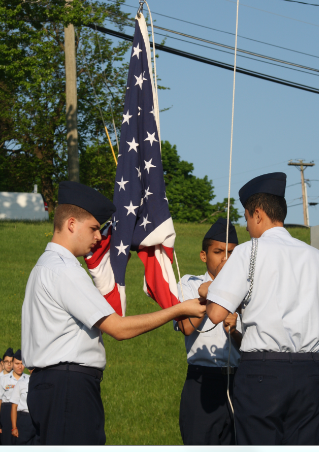 Members of AFJROTC raise the flag during a ceremony Wednesday commemorating Memorial Day.