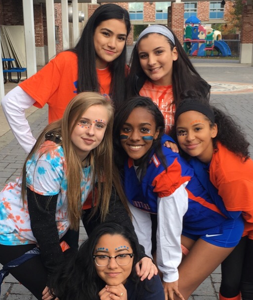 Students pose for a picture on Orange and Blue day last year.