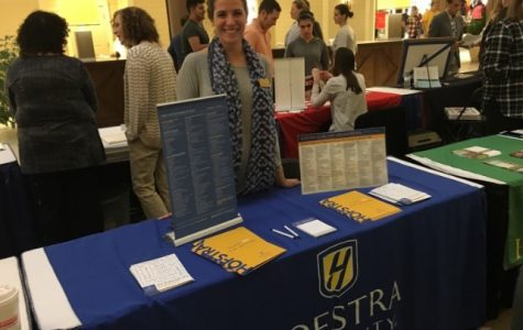 Courtney Cyr, Associate Dean of Hofstra University, engages with students about their future college endeavors.