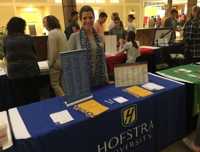 Courtney+Cyr%2C+Associate+Dean+of+Hofstra+University%2C+engages+with+students+about+their+future+college+endeavors.+