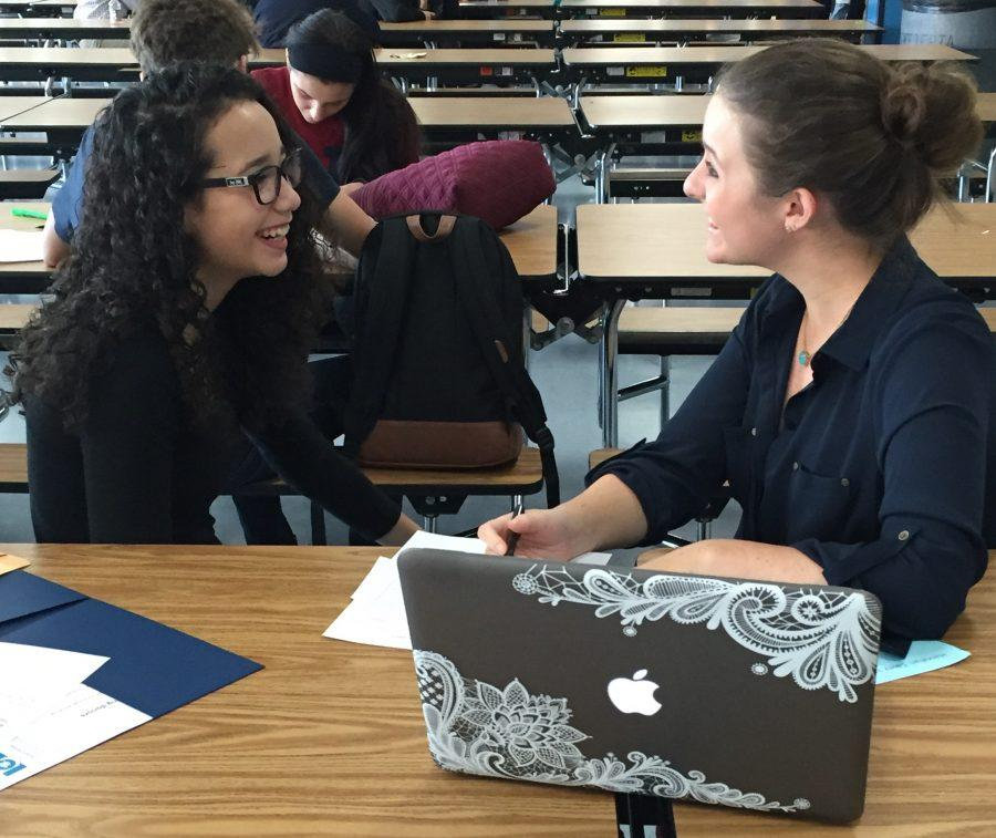 English teacher Casey Hanrahan and Junior Taina Colon conferencing about grades during a recent Advisory.