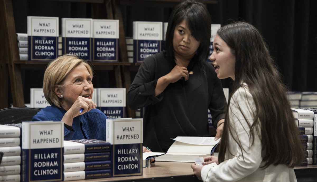 DHS+alumna+Lexie+Prendergast+talks+with+Hillary+Clinton+at+her+recent+book-signing+event+at+Costco+in+Brookfield.+Clinton%2C+a+former+first+lady%2C+senator%2C+secretary+of+state%2C+and+two-time+candidate+for+president%2C+gave+Prendergast+her+card.