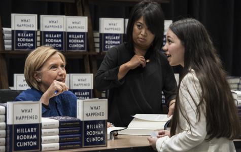 DHS alumna Lexie Prendergast talks with Hillary Clinton at her recent book-signing event at Costco in Brookfield. Clinton, a former first lady, senator, secretary of state, and two-time candidate for president, gave Prendergast her card.