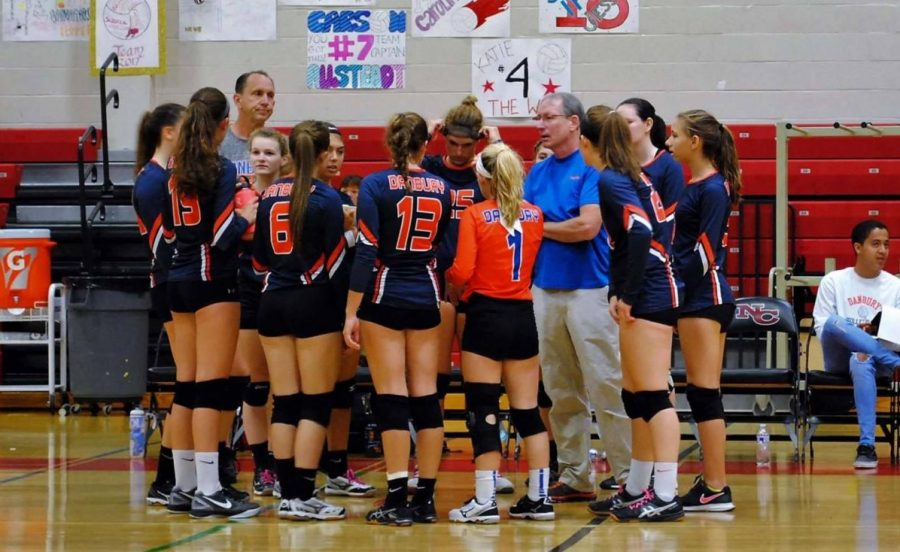 The team gathers together for a pre-game pep talk.