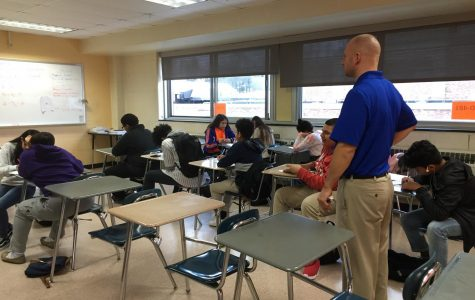 Casey Bock, math teacher, watches over his freshman class while in block scheduling.