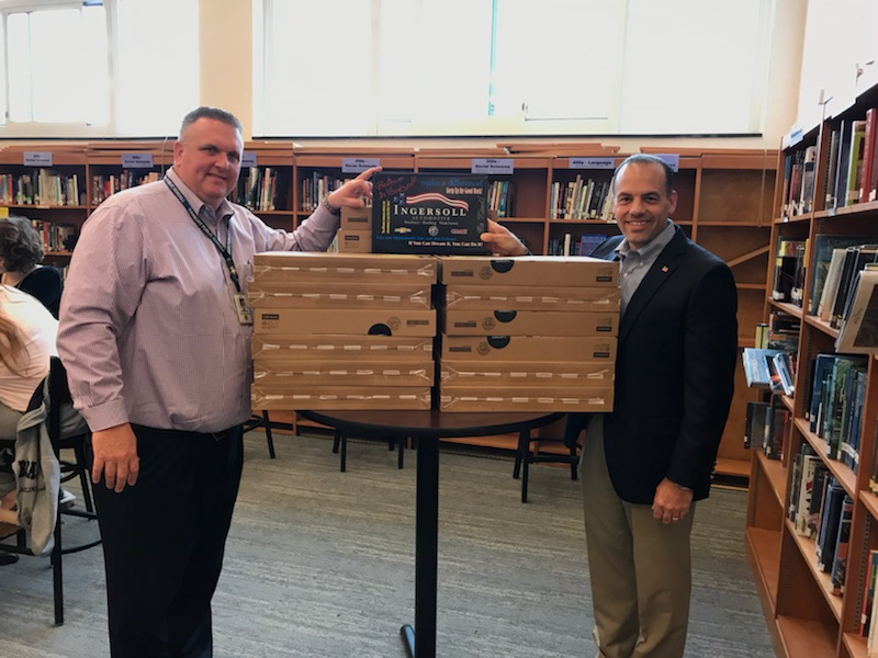 Todd+Ingersoll+stands+with+Principal+Dan+Donovan+and+boxes+of+donated+laptops.