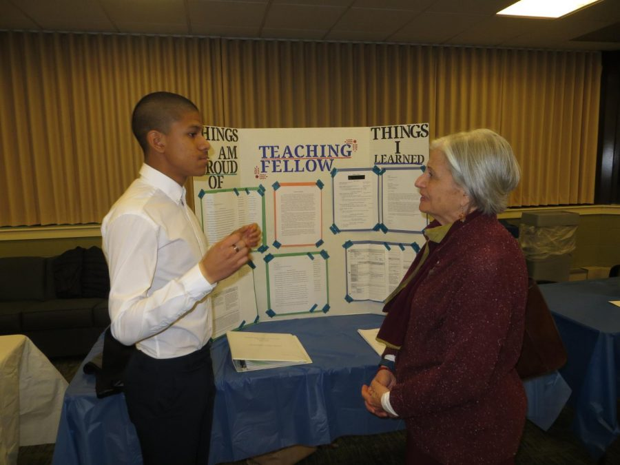 Nelson Neira presents his poster to Patricia Ivry, interim dean for the School of Professional Studies at Western Connecticut State University.