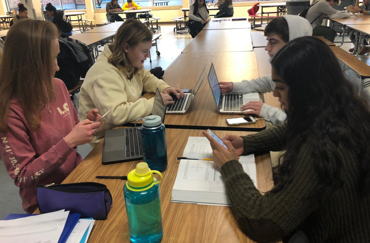 A group of students use DPS-OpenWiFi on their personal devices during their study hall.