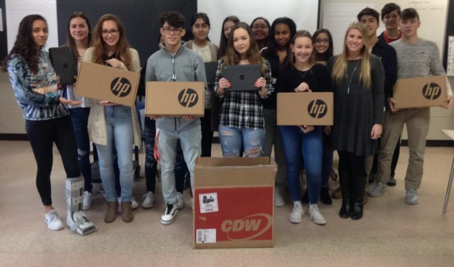 English teacher Arielle Fischer's students pose with the Chromebooks they received from DonorsChoose.org through a Dalio Foundation grant.
