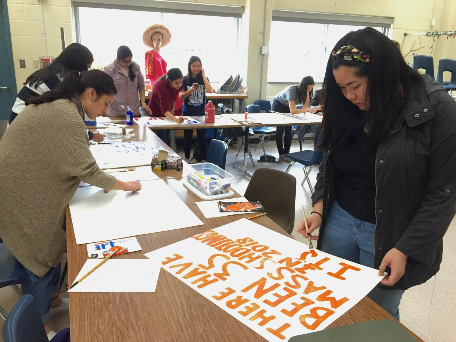 Students make posters for the Advocacy Initiative on March 14.