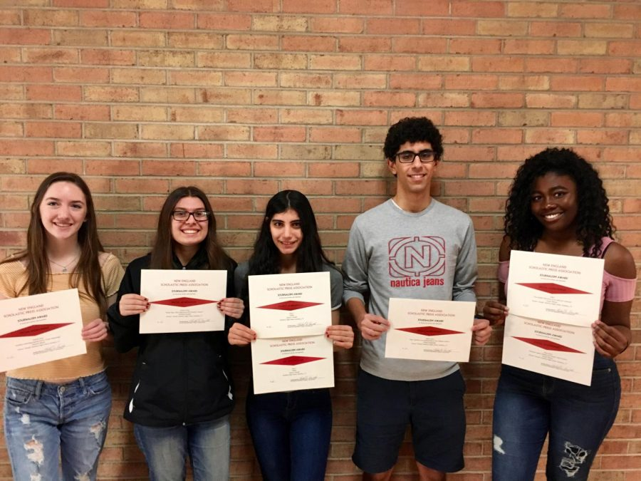 From left, photo chief Shannon Ahearn, staff writer Elizabeth Hadden, editor-in-chief Katie Walsh, sports editor Hisham Rushaidat, and arts & clubs editor Naomi Thomas were honored with achievement awards from the New England Scholastic Press Association.