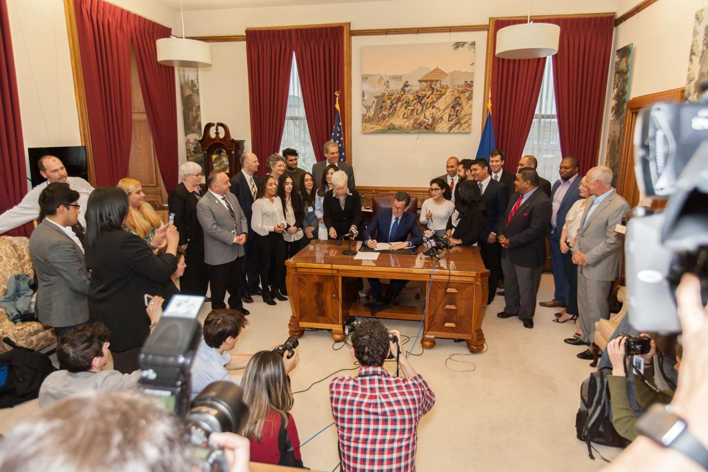 State legislators sign the SB4 bill into a law.