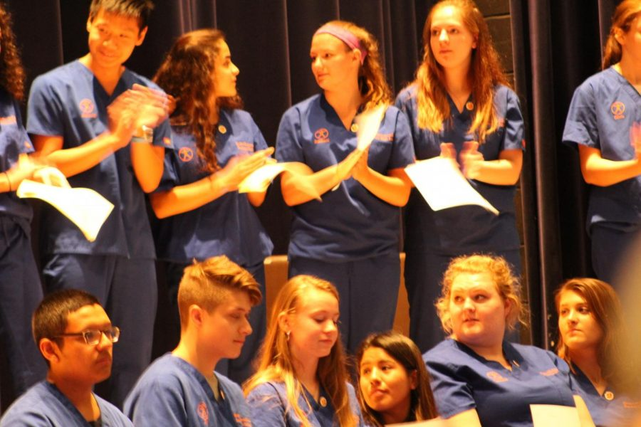 Students who passed their Certified Nursing Assistant exams receive their CNA pins during HSBA's ceremony on Tuesday. Teachers Katie Tong and Nicole Gurney run the rigorous program.
