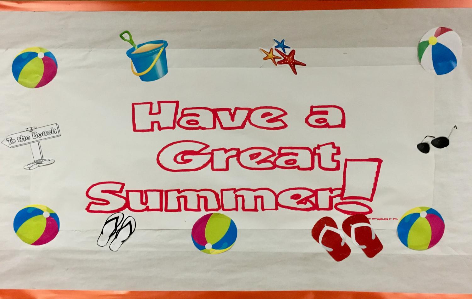 The bulletin board near the Main Office gives summer wishes.