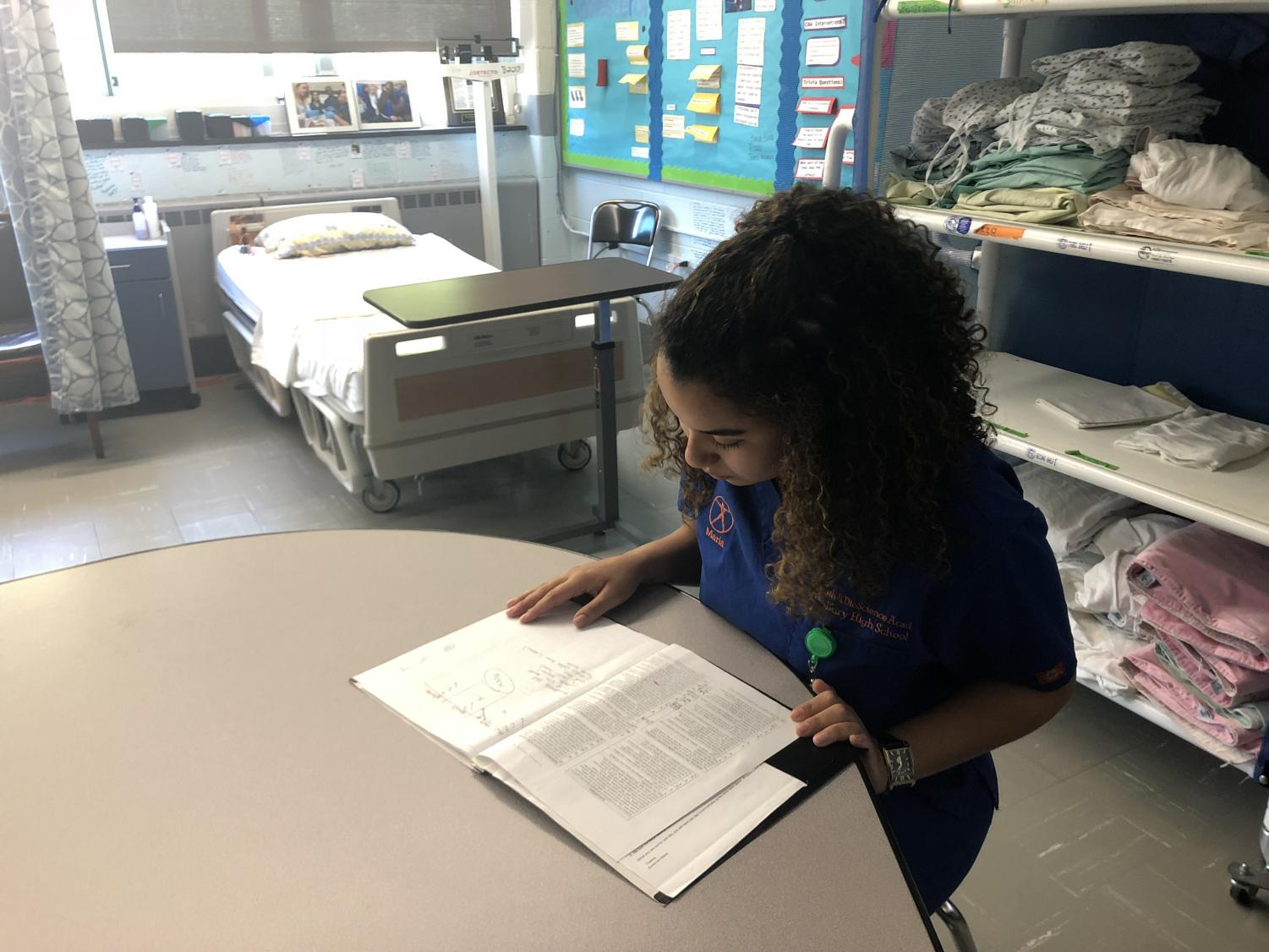 Senior Health and Bioscience Academy student Maria Garcia studies for her upcoming exam to become a certified CNA.