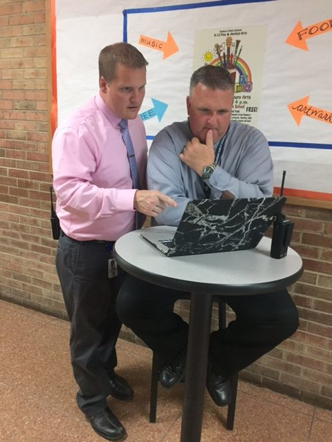 Principal Dan Donovan and Assistant Principal in charge of the Freshman Academy, Kris  Davidson, are  looking at information for next year's schedule.