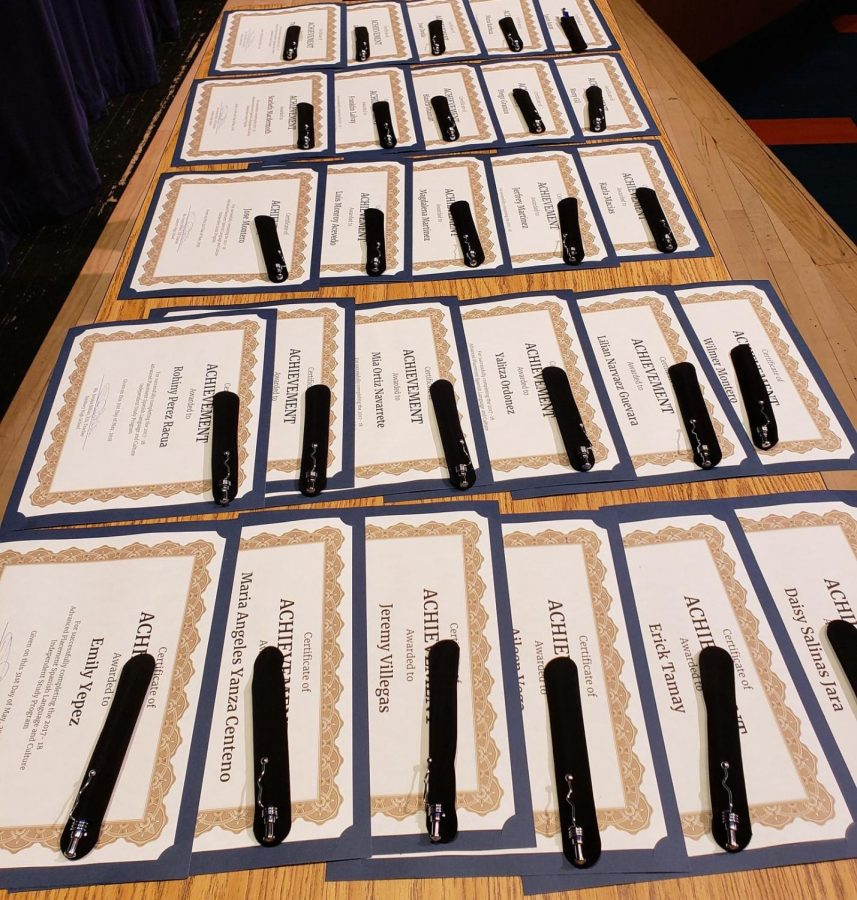 Certificates and gifts laid out before the presentation honoring ESL students who prepared and sat for the AP Spanish Language and Culture exam as an independent study.