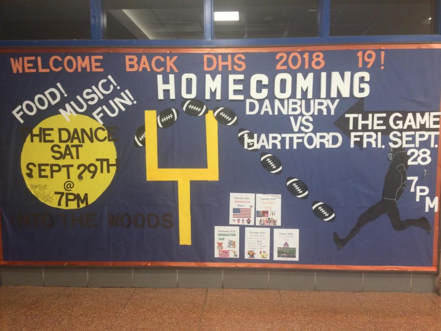 The bulletin board in the main entrance describes each day of spirit week.