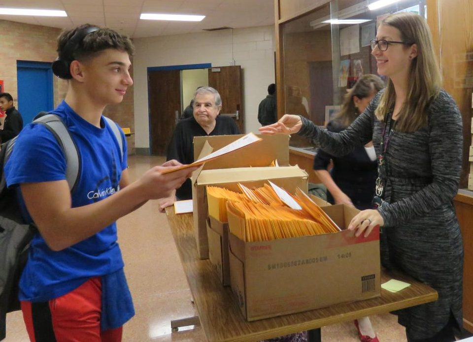 Freshman Isaac Pereira talks with 9th-grade counselor Jennifer Ondek on his way into this year's Freshman Forum.