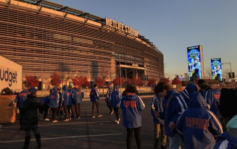 Members of the marching band wait outside of MetLife Stadium after their performance.