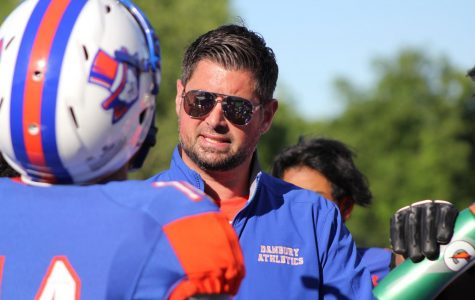 Augustine Tieri coaching his 4-6 football team.