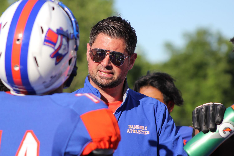Augustine Tieri coaching his 4-6 football team.