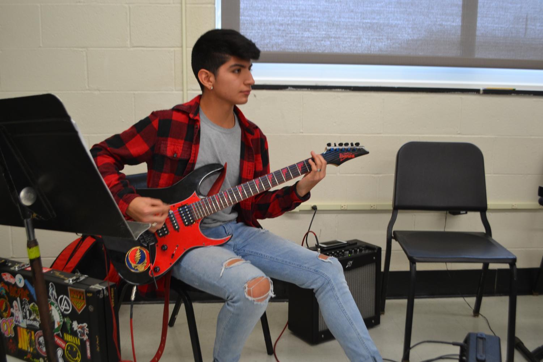 Junior Alexis Ortega plays along in Susan McKenzie's flex extension, Modern Rock Band.