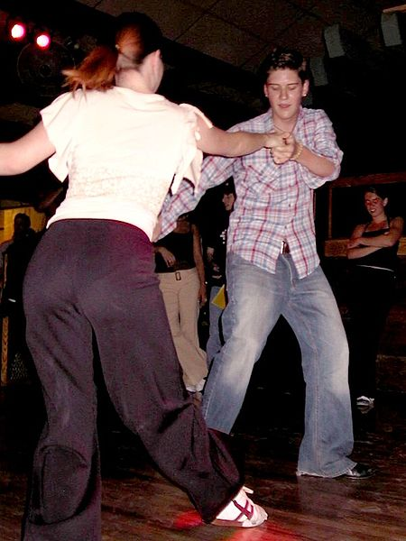 ESL teacher Soraya Bilbao enjoys swing dancing, just like this couple dancing the Lindy Hop.