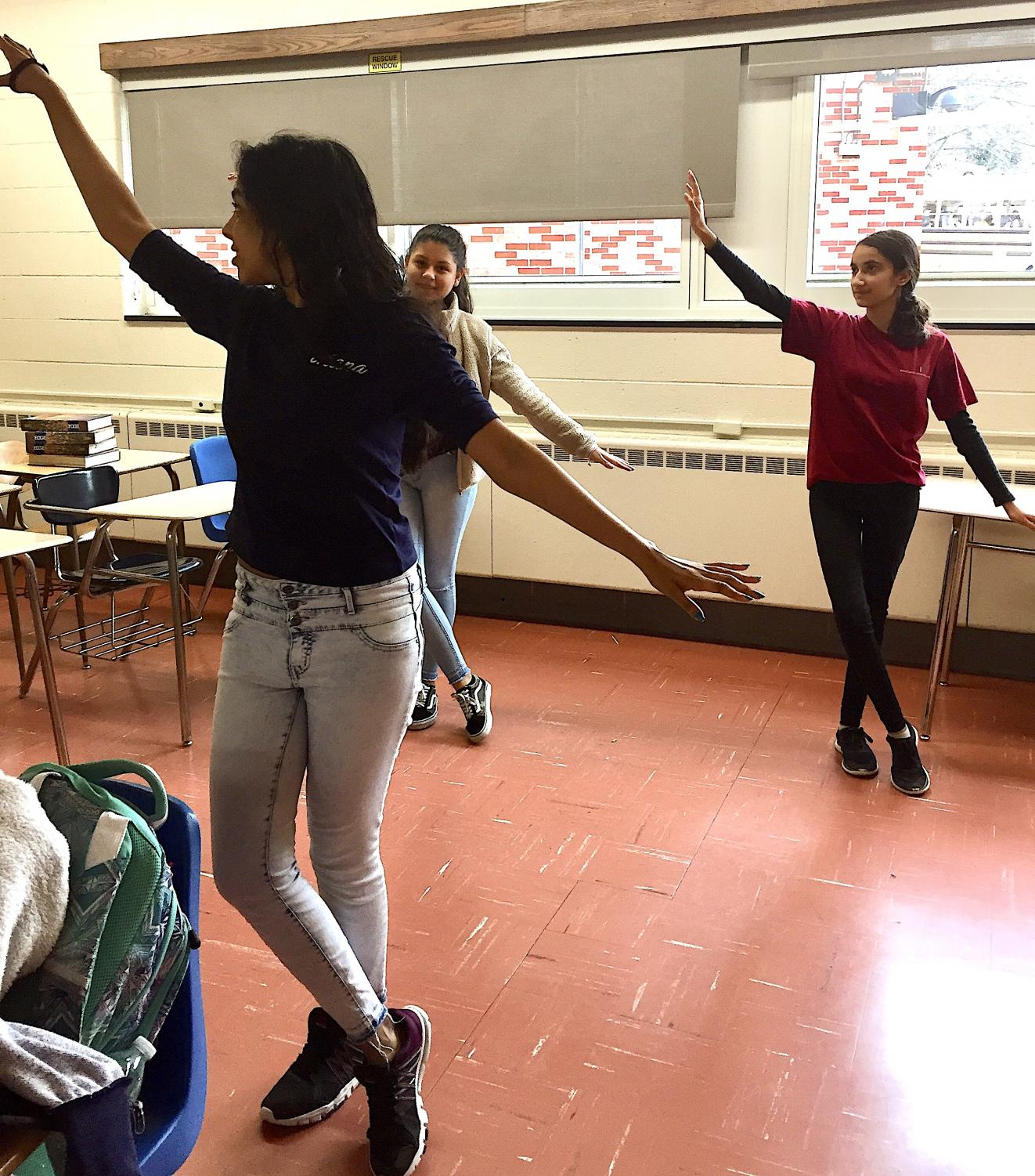 Bollywood Club president Aleena Jacob (foreground) instructs a dance routine during a recent club meeting. Members  Jennifer Alvarez and Hibba Quershi, both sophomores, follow her lead. The club meets every Friday in C 335.