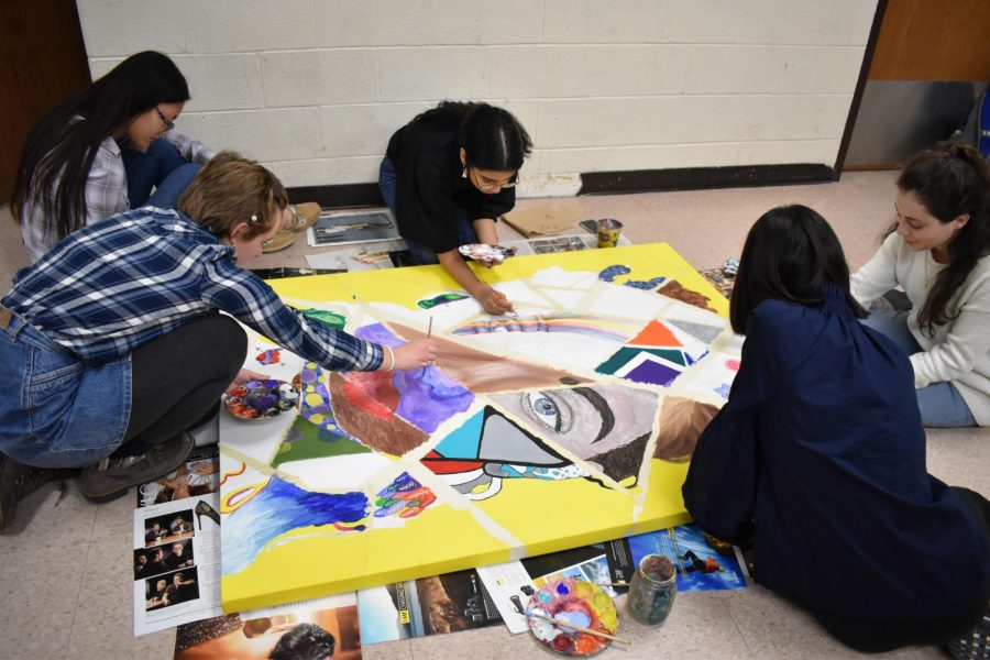 National+Art+Honor+Society+students+work+on+a+painting+led+by+senior+Elizabeth+Mcbrian+after+school+in+the+A+building.+