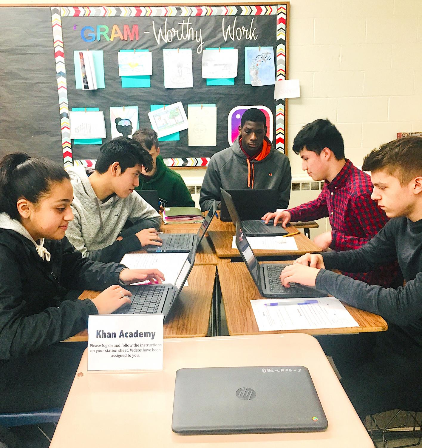 From left, juniors, Ashley Amigon, Anthony Salinas, Nicholas Alfidi, Masta Joyner, John Rodriguez-Galarza, and Cameron Tate in Alexandrea Plante's English III class use new Chromebooks to work on a Khan Academy exercise during class.