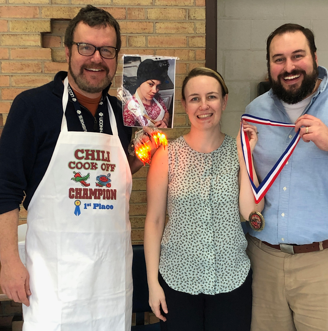 The Sophomore Class held its annual Chili Cook-off on Feb. 22.  Dave Honeyford, left, won Best Overall, Megan Hughes (Honeyford is holding a photo of her) won
