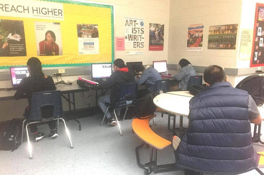 Students work on researching colleges, scholarships and the application process at the Career Center.