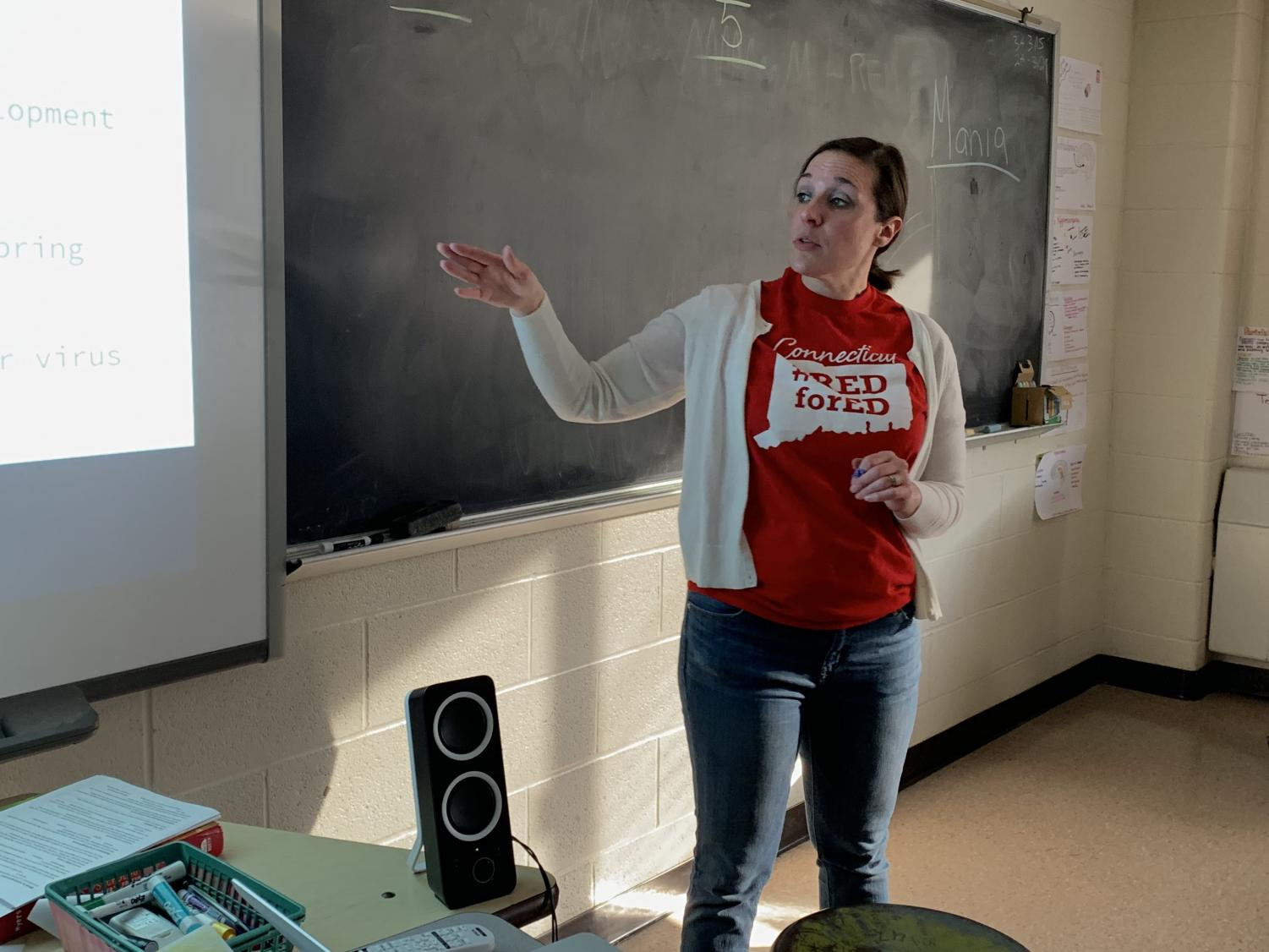 Lindsey Stoffa, psychology teacher, wears the Red for Ed t-shirt on Wednesday, March 20, in support of NEA-Danbury's school budget campaign. Stoffa is also the union's co-chair of its Teacher Evaluation Committee.