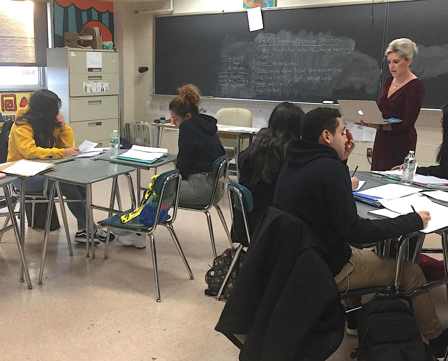 Stacey Brugnolo, head of the ELL department and transitional English teacher, recently conducts class.