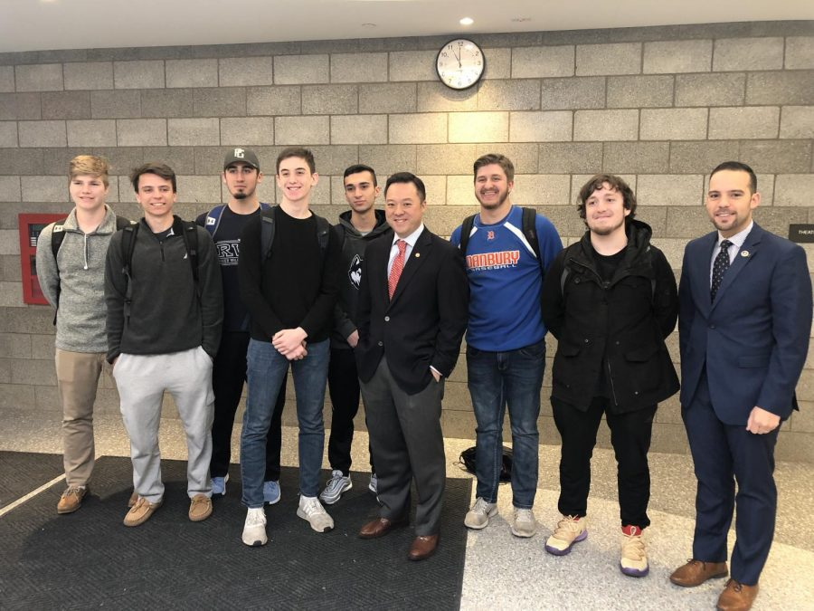 Attorney General Tong poses with students outside of the black box theater following his presentation during flex.