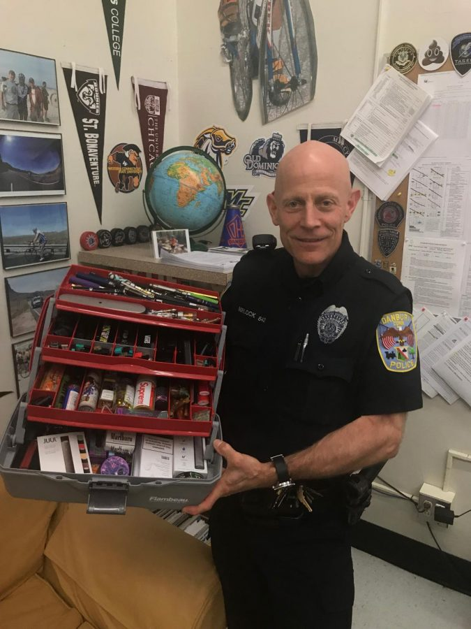 Officer Morlock stands with the collection of vapes, wax pens, pods, juices, carts, and even cigarettes that hes accumulated over his years at DHS. Although when any one of these items is found on a student it is considered evidence to the police, everything seen here he has simply found throughout the school.