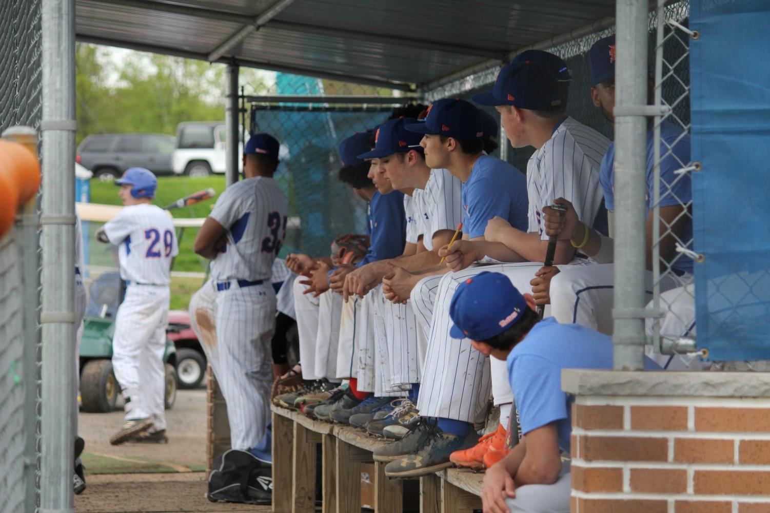 The Danbury Hatter baseball team in the dugout during a home game. The Hatters are currently 12-7, with a 10-6 in conference record.