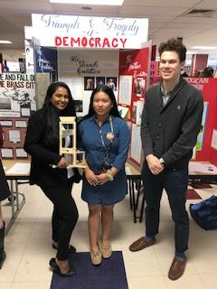 NSSHS students, from left, Rishita Bandaru, Lori Sigua and Shay Fashbender stand in front of their Connecticut History Day project on the topic of impactful revolutions.