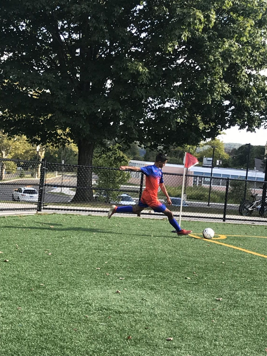 Victor Oliveira takes a corner kick for the Hatters against Darien on Friday  Sep. 13