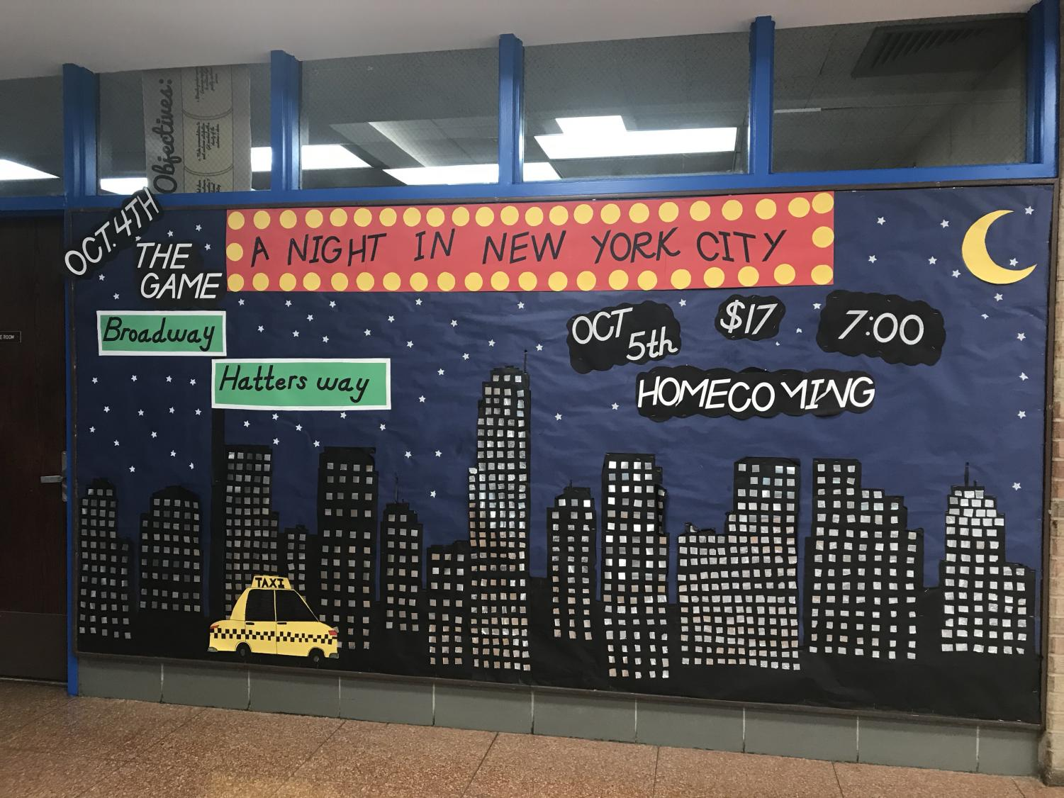 DHS puts up bulletin board to promote the 2019 Homecoming Dance.