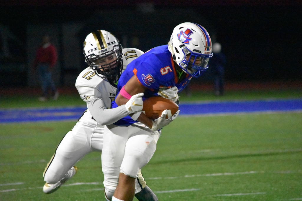 Danbury's Nick Smith is tackled in a football game between Danbury and Trumbull at Brookfield high, Brookfield on Saturday, Oct. 19, 2019. (Pete Paguaga, Hearst Connecticut Media)