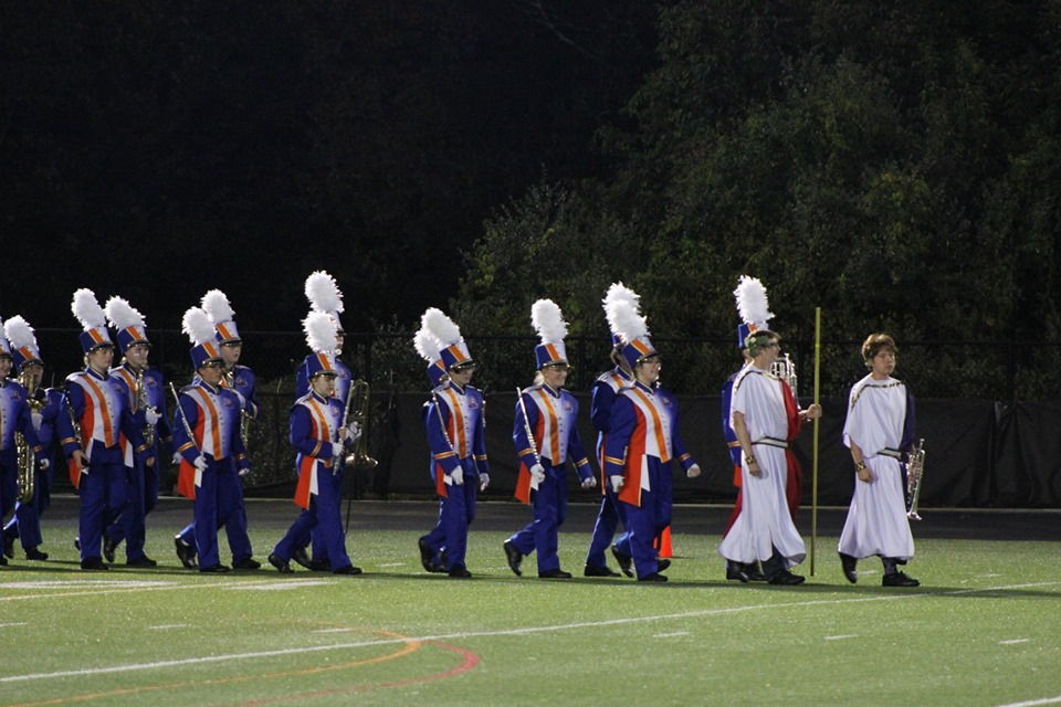 DHS Marching Band, led by Drum Majors Matthew Henry and Luke Lefflbine (far right), perform at halftime during the Homecoming game (Oct. 4).