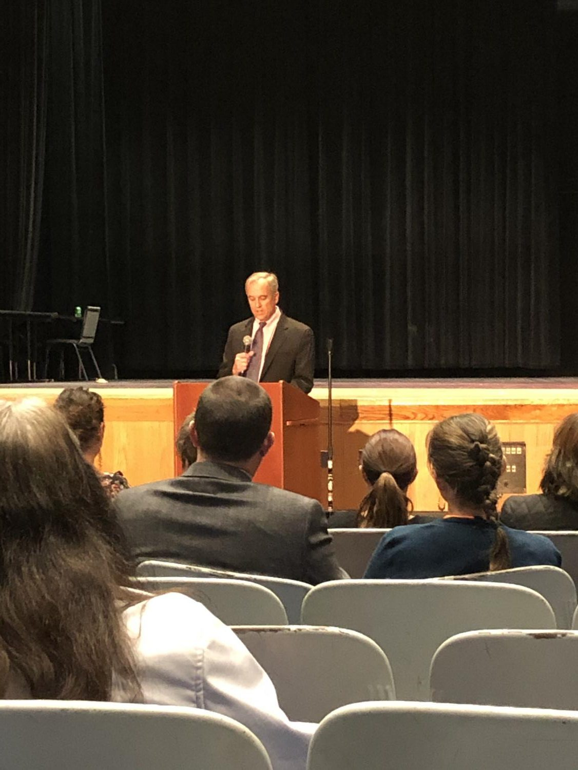 NEASC Committee member Scott Leslie gives initial recommendations to the DHS staff on Wednesday, Nov. 20 during concluding ceremonies.