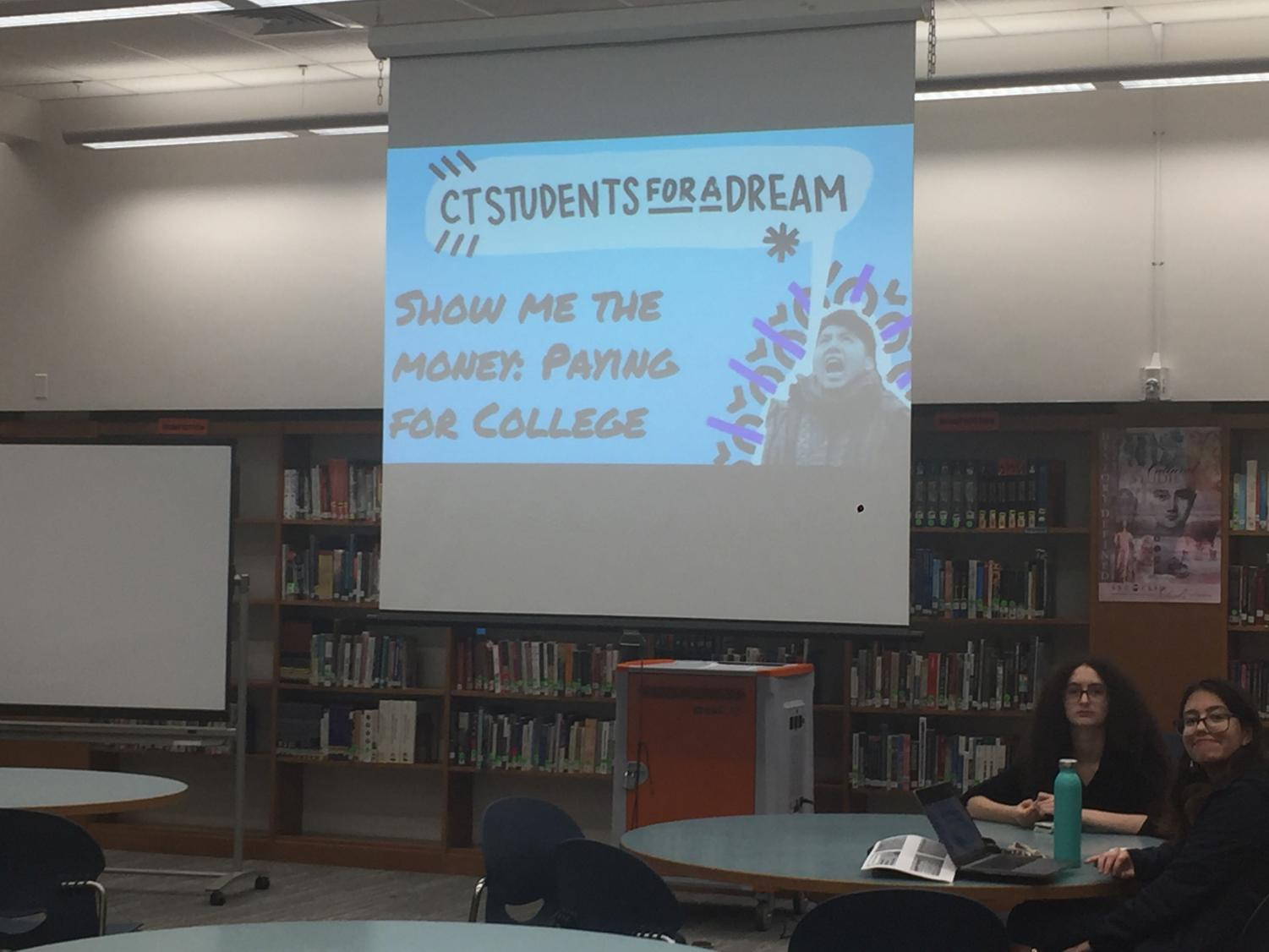 Lead Danbury-Coordinator for CT Students For a Dream Angelica Idrovo projects her Financial Aid Night presentation and prepares her student volunteers.