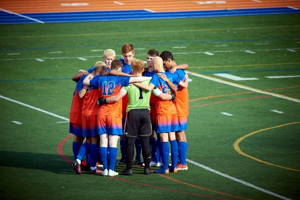 Danbury boys huddle together during states game.